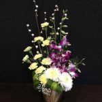 Orchids carnations Chrysanthemum arrangement